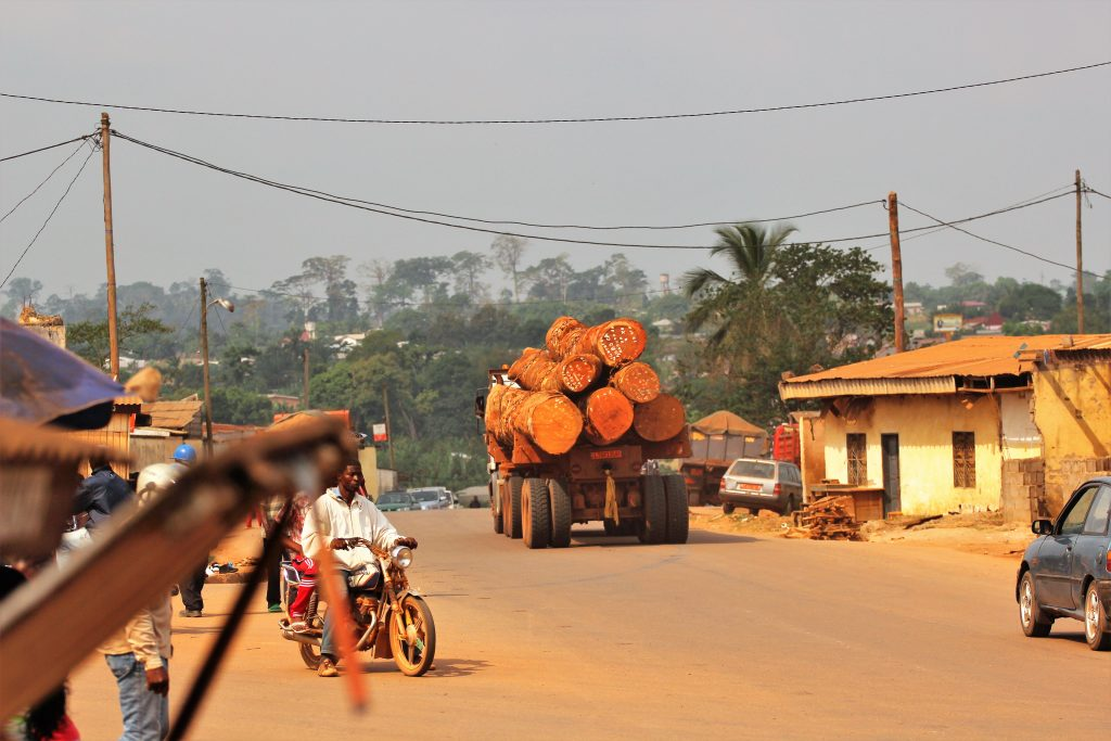 A truck loaded with timber on its way to the port city of Douala. Photo Credit: Nforngwa/Africa Assignments